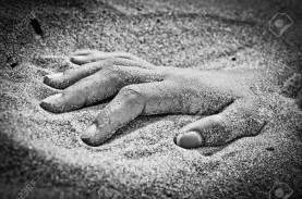 hand in rigor mortis on the beach